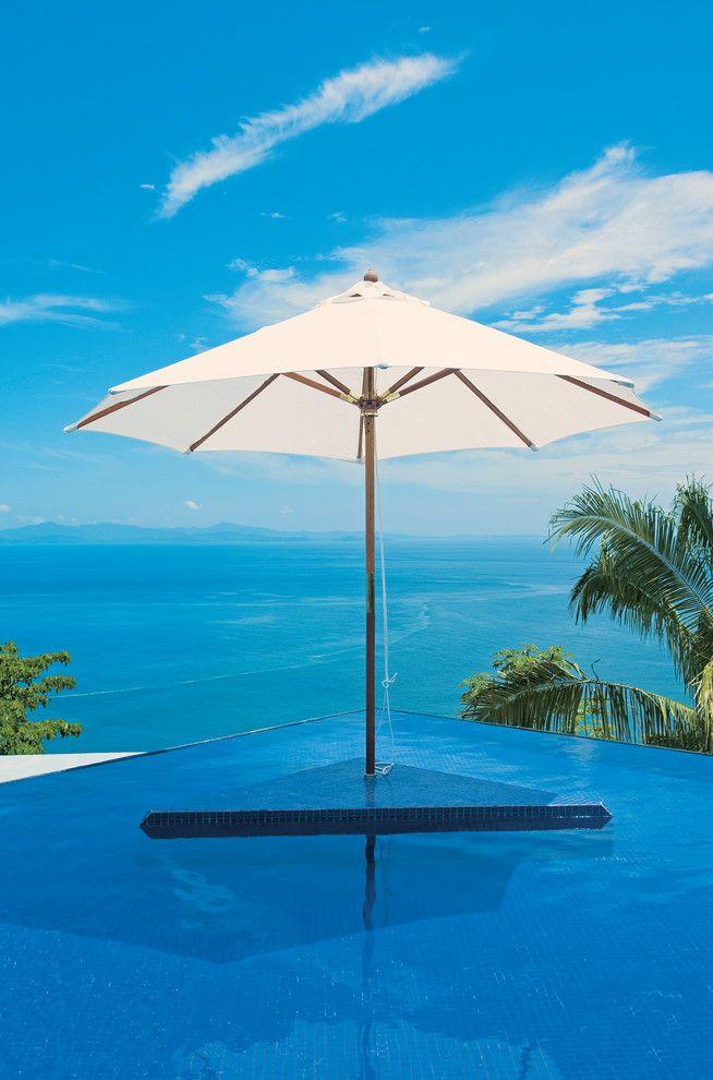 Pura Vida Miami for a Tropical Pool with a Contemporary and Pura Vida House by Desarrollos Latinos