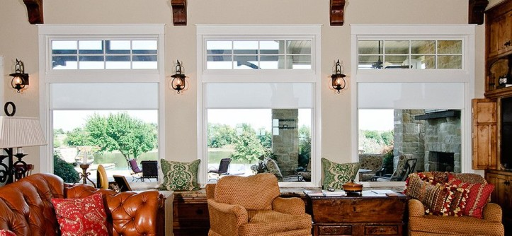 Qmotion Shades for a Farmhouse Family Room with a Lakehouse and Country Comfortable by AV Innovations