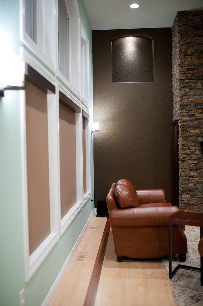 Qmotion Shades for a Traditional Spaces with a Light Wood Floors and Jackson Audio/video Facelift by Custom Cinema & Sound