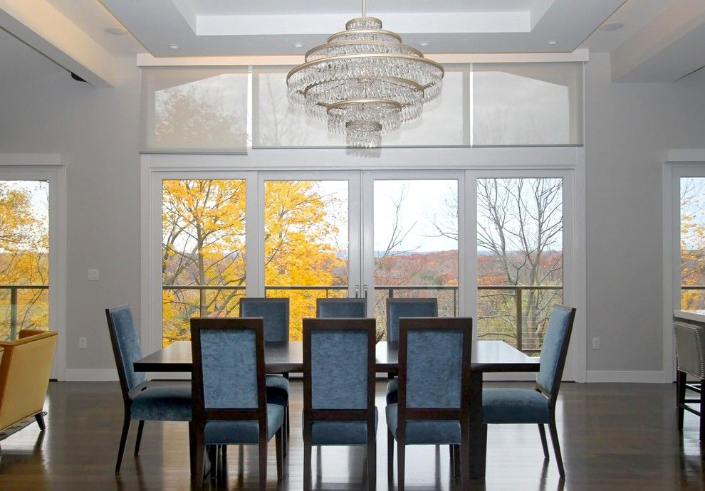 Qmotion Shades for a Transitional Dining Room with a Luxury Chandelier and Chestnut Hill Project by Marie Share Interiors