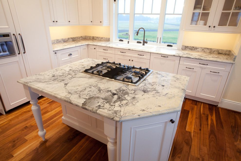 Quartz Countertops vs Granite for a Traditional Kitchen with a Hardwood Floors and Super White Quartzite Kitchen in Calvert County, MD by Granite Grannies