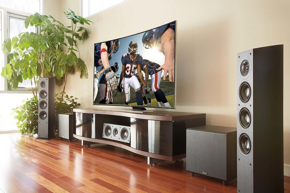 Quincy University Football for a Contemporary Family Room with a Entertainment Center and Family Rooms by Magnolia Design Center