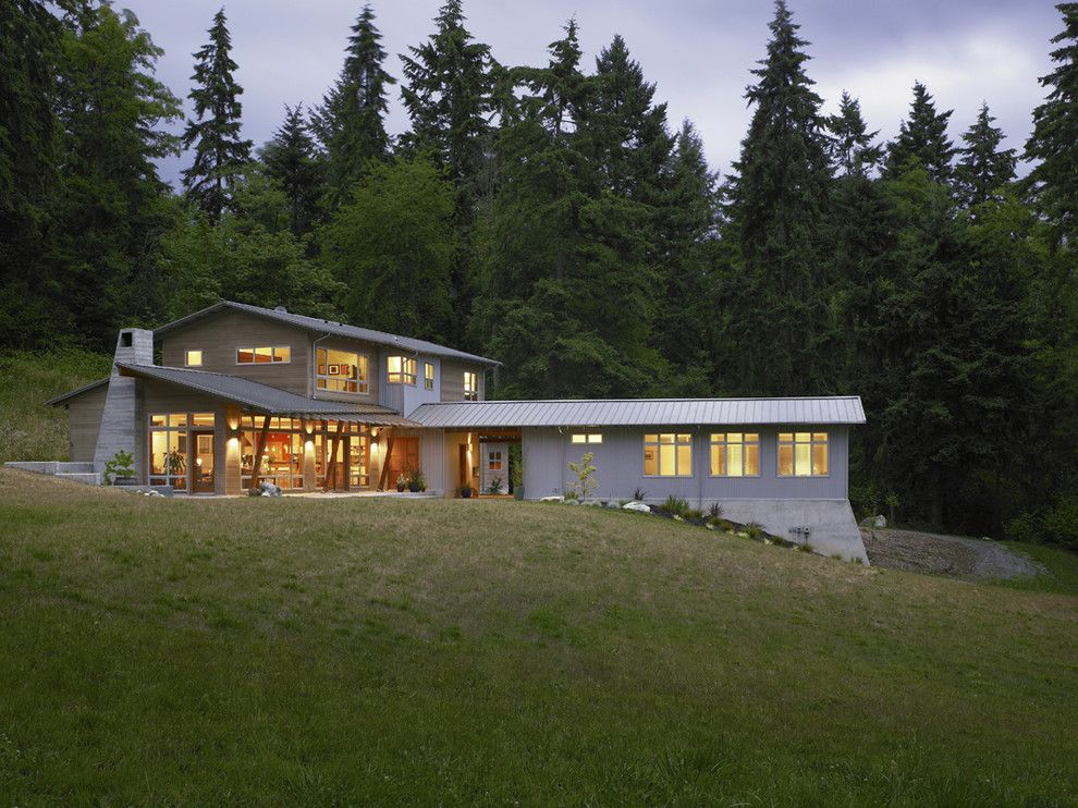 Railroad Tie Retaining Wall for a Contemporary Exterior with a Overhang and Vashon Residence by Goforth Gill Architects