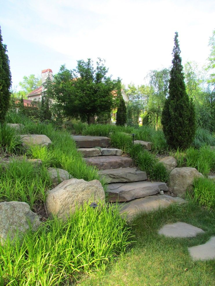Railroad Tie Retaining Wall for a Mediterranean Landscape with a Stepping Stones and Elegant Estate by Rutgers Landscape Design