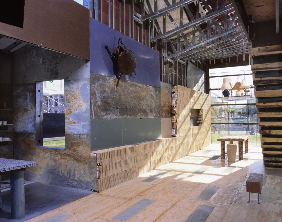 Railroad Tie Retaining Wall for a Rustic Hall with a Glass Wall and Scraphouse by Jensen Architects