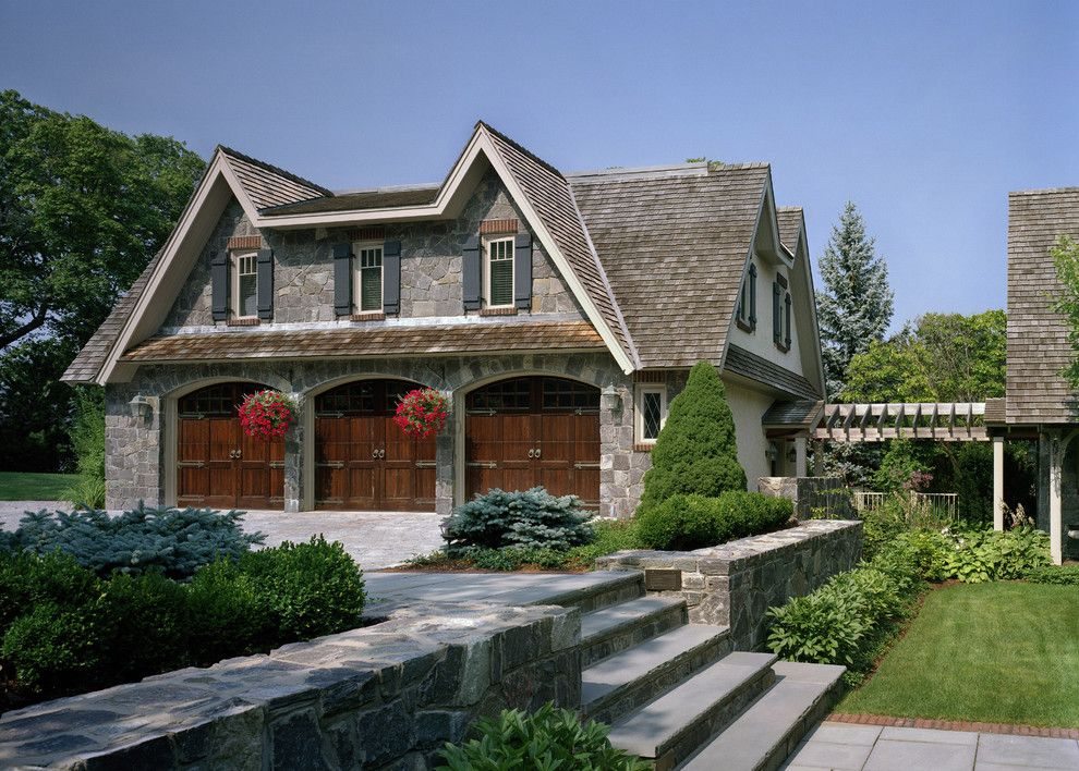 Railroad Tie Retaining Wall for a Traditional Garage with a Planting and Storybook by Siemasko + Verbridge