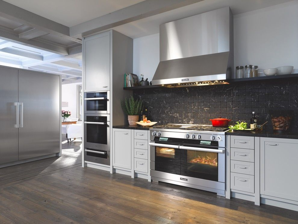 Rakks Brackets for a Contemporary Kitchen with a Black Countertop and Miele by Miele Appliance Inc