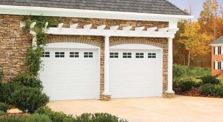 Raspberry Trellis for a Mediterranean Garage with a Exterior and Raised Panel by Empire Overhead Doors, Llc