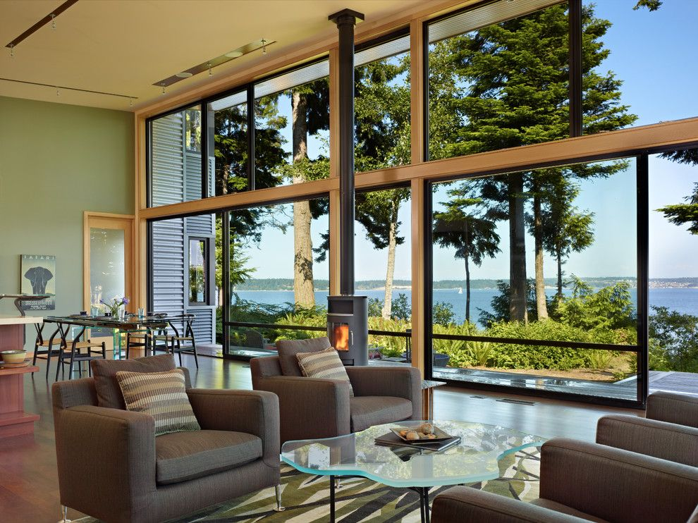 Raymond Building Supply for a Modern Living Room with a Natural Wood Trim and Port Ludlow House by Finne Architects