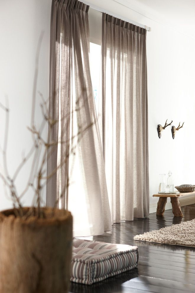 Raynor Doors for a Contemporary Bedroom with a Shutter and Linen Pinch Pleat Drapery Panels by Budget Blinds