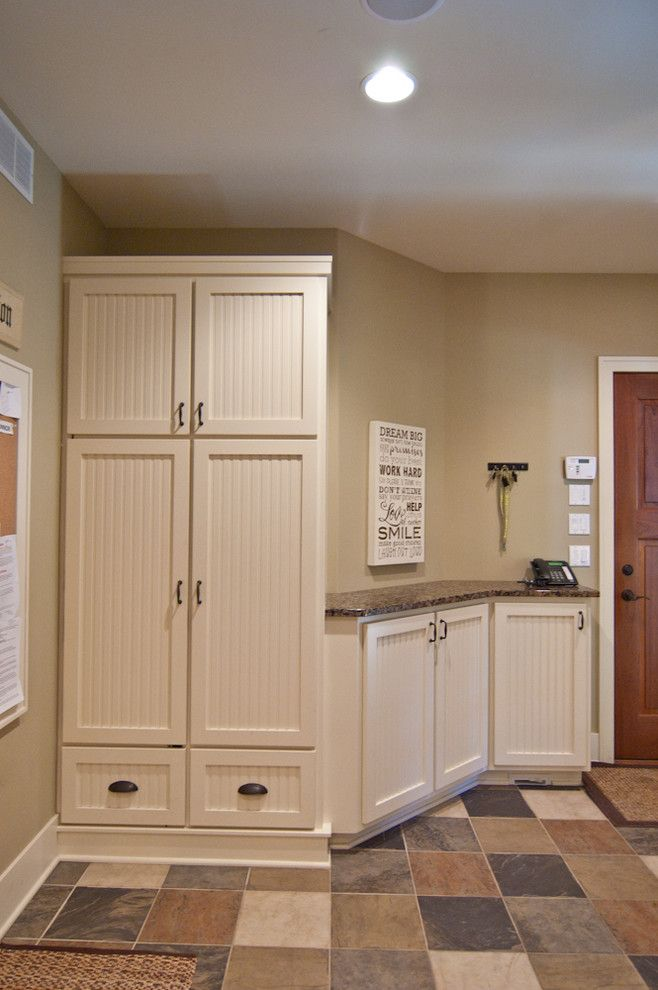 Raynor Doors for a Rustic Entry with a Brookhaven Cabinets and Country Estate by Troxel Custom Homes