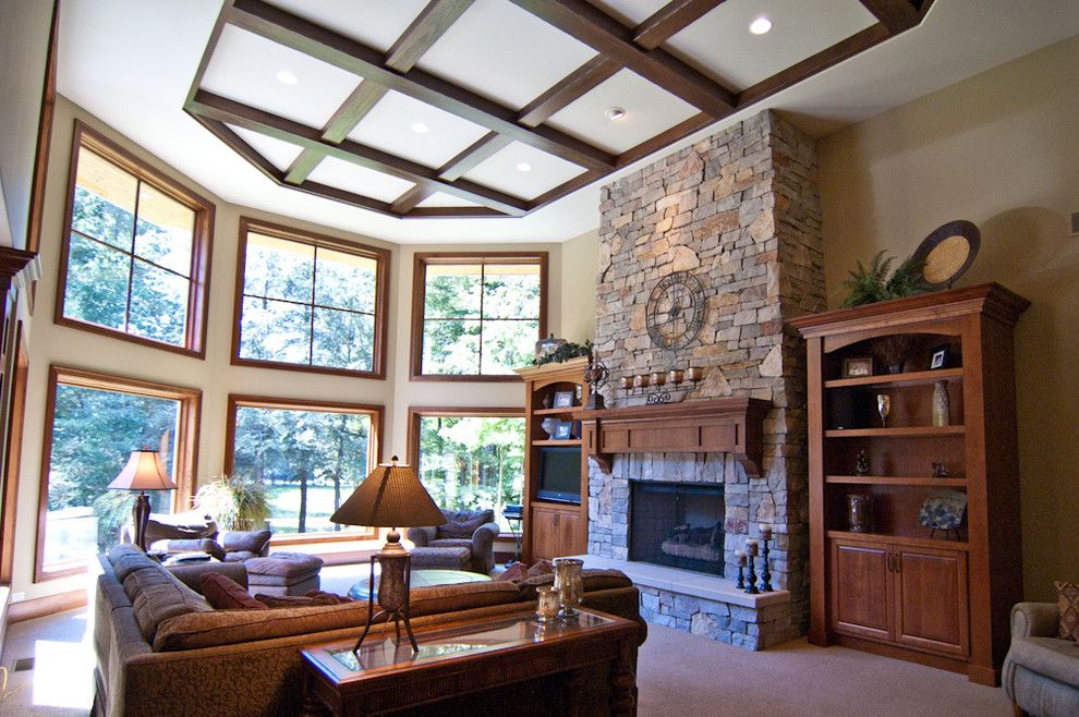 Raynor Doors for a Rustic Living Room with a Sub Zero and Country Estate by Troxel Custom Homes