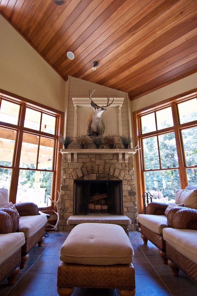 Raynor Doors for a Rustic Porch with a Wolf and Country Estate by Troxel Custom Homes