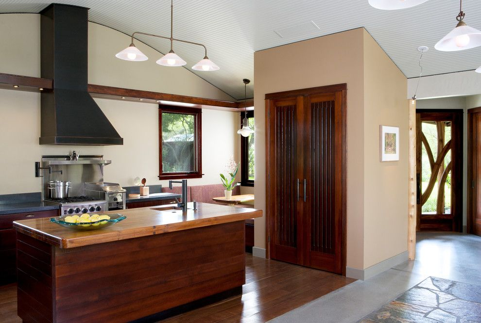 Redlands Theater for a Contemporary Kitchen with a Metal Range Hood and Baer Retreat by Osborne Architects