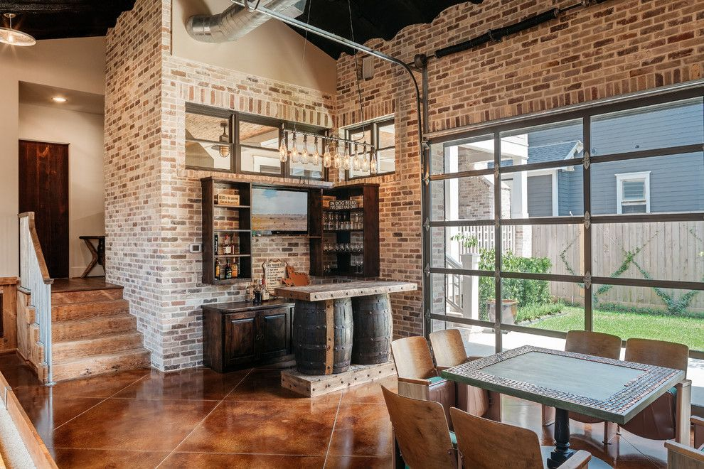 Redlands Theater for a Rustic Home Bar with a Brown Floor Tile and Whitestone Builders   Industrial Rustic Transitional by Whitestone Builders