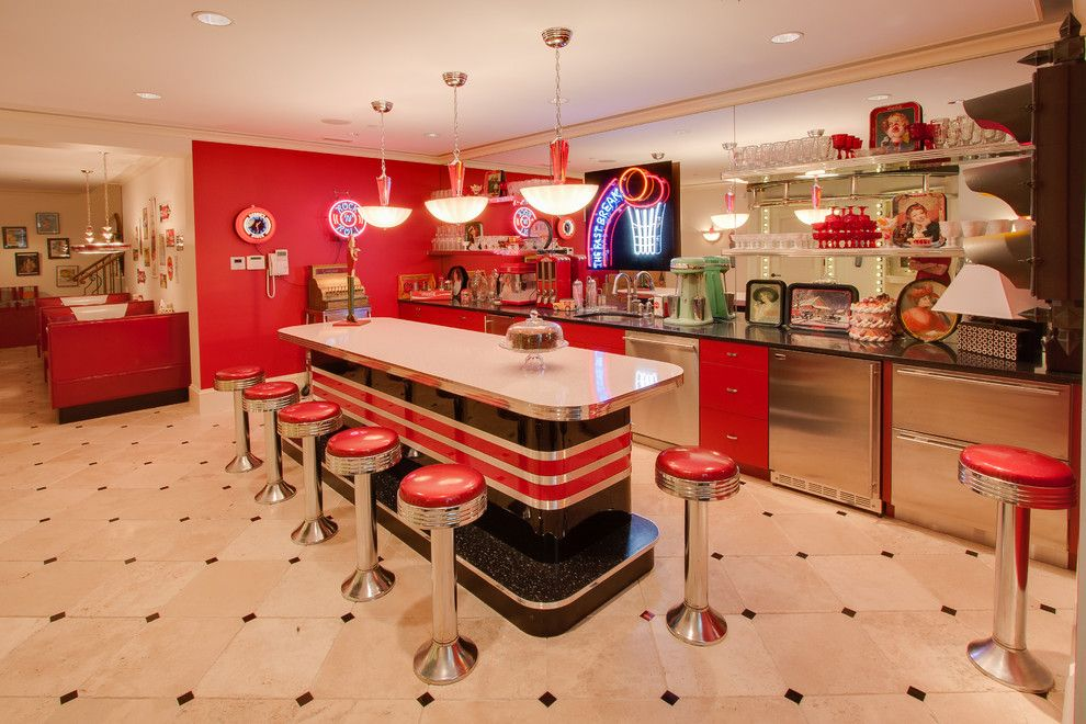 Redlands Theater for a Traditional Basement with a Red Cabinets and Bars & Wine Rooms by Heartwood Design
