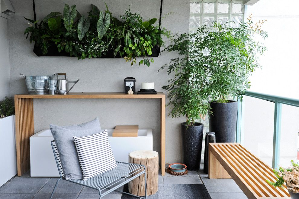Renovate Credit Card for a Modern Balcony with a Deck and West 2nd Street, North Vancouver by Gaile Guevara