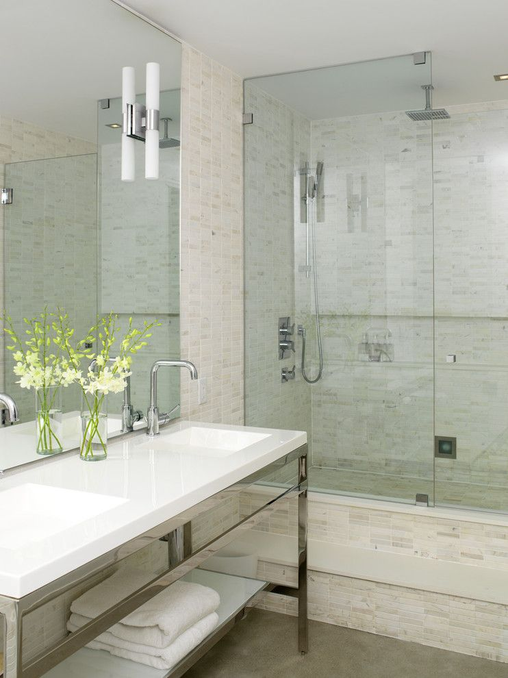 Replacing Shower Faucet for a Industrial Bathroom with a Neutral Colors and Modern Ensuite by Croma Design Inc