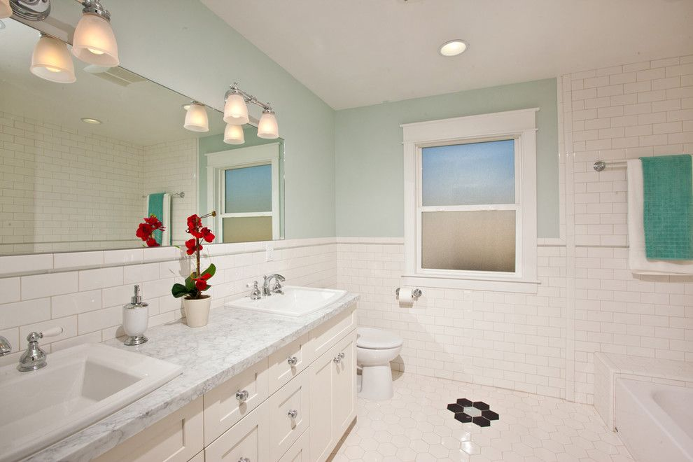 Restorations Hardware for a Traditional Bathroom with a Hexagonal and Craftsman Rebuild by Stewart Thomas Design Build