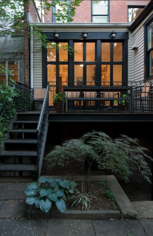 Rewiring a House for a Transitional Deck with a Deck and Brooklyn Heights Brownstone by Godwin Residential Construction