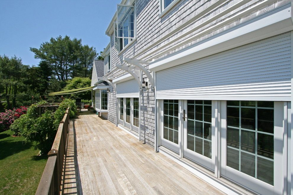 Rhino Shield Cost for a Contemporary Exterior with a Coastal Home and Rollshutters by Shade and Shutter Systems, Inc