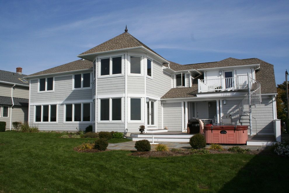Rhino Shield Cost for a Transitional Exterior with a Rollshutters and Rollshutters by Shade and Shutter Systems, Inc