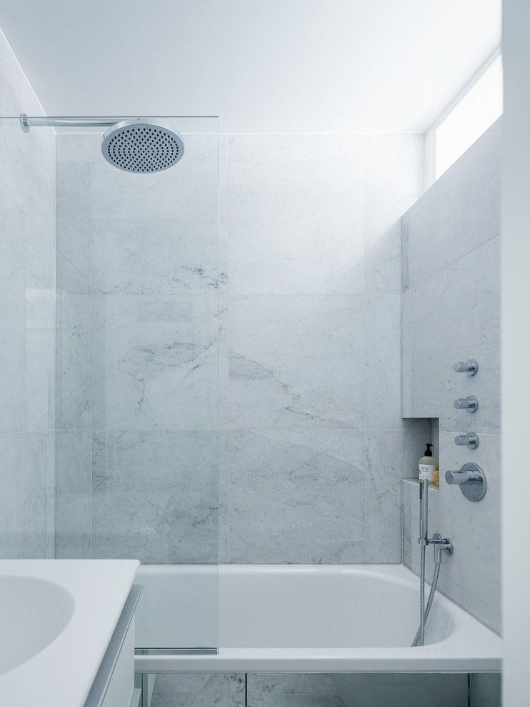 Rittenhouse Hill Apartments for a Modern Bathroom with a Glass Shower Screen and Primrose Hill Apartment by Amos Goldreich Architecture
