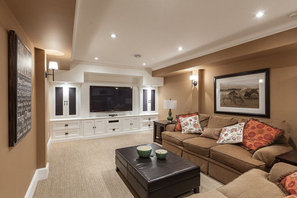 Rocky Mount Theater for a Transitional Family Room with a Built in Entertainment Center and My Houzz: Traditional Home with Cottage Flair by Becki Peckham