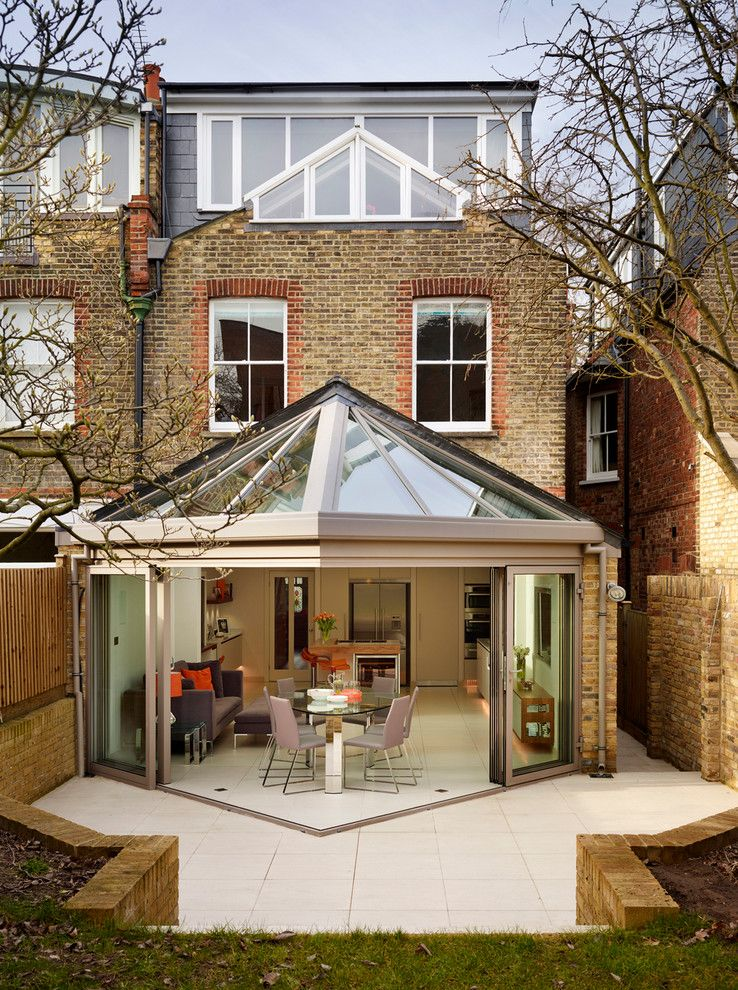 Roofs or Rooves for a Contemporary Exterior with a Flat Arches and White Bespoke Kitchen by Roundhouse
