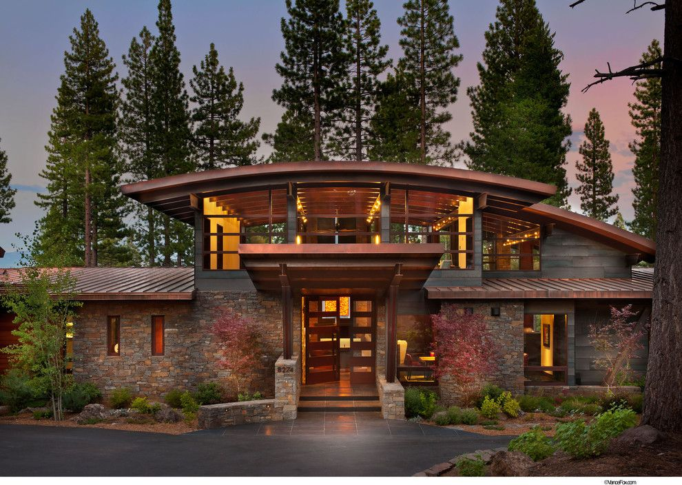 Roofs or Rooves for a Rustic Exterior with a Metal Roof and Entry by Ward Young Architecture & Planning   Truckee, Ca
