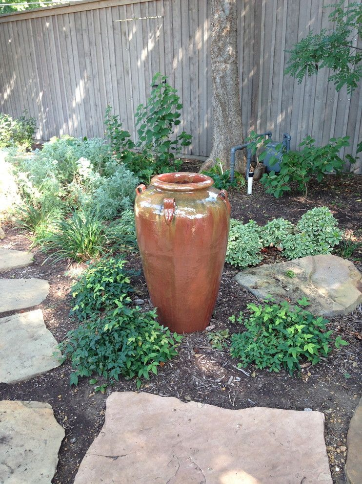Roundtree for a Eclectic Landscape with a Texas Tough and Natural Back Yard with Water Feature by Roundtree Landscaping, Inc