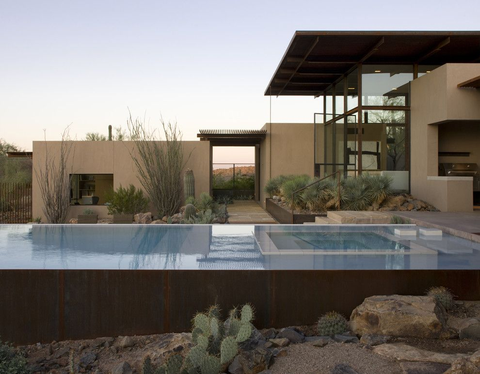 Ryland Homes Az for a Southwestern Pool with a Custom Shade Overhang and the Brown Residence by the Construction Zone, Ltd.
