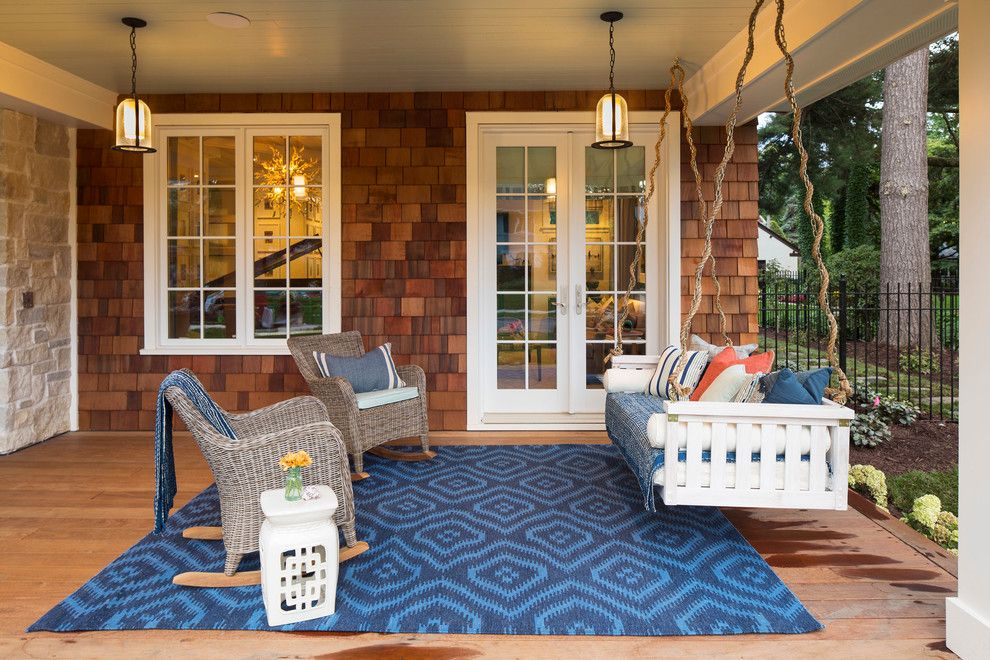 Sag Harbor Gym for a Beach Style Porch with a Porch Swing and Coastal Chic by Laura Engen Interior Design