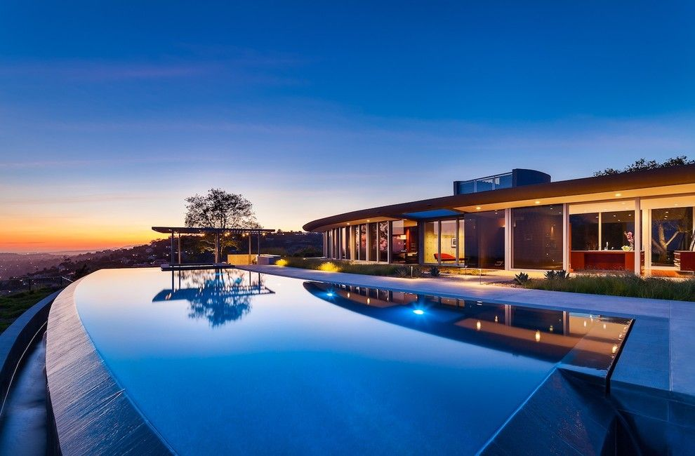 Santa Barbara Back Page for a Modern Pool with a Curve and Kurth Residence by Neumann Mendro Andrulaitis Architects LLP