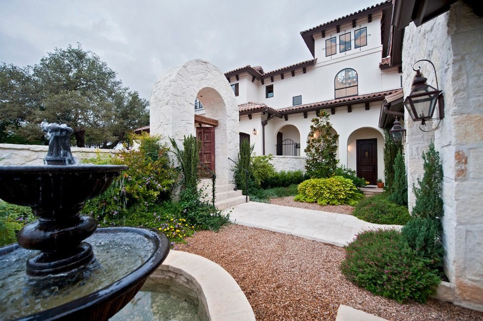 Santa Barbara Presidio for a Mediterranean Landscape with a Fountain and Santa Barbara Style in Austin by Jenkins Custom Homes