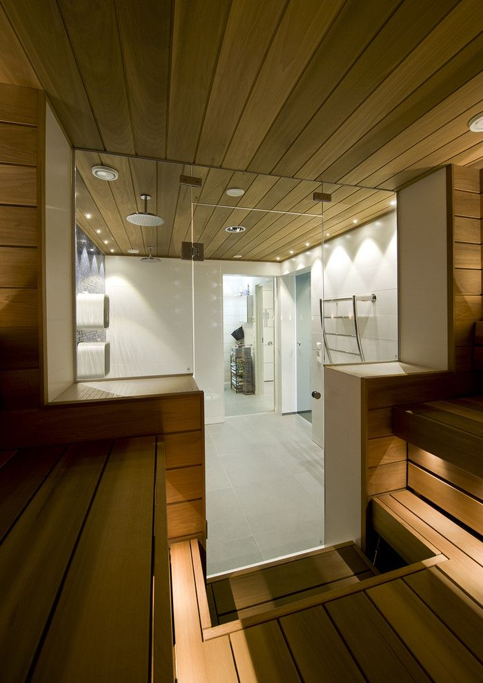 Sauna vs Steam Room for a Contemporary Bathroom with a Shower Room and Swimming Pool, Shower Room and Sauna Divided by Glass Doors by Decom Interiors