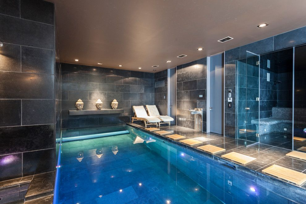 Sauna vs Steam Room for a Contemporary Pool with a Buddha Head and Wimbledon Mansion by Chris Snook
