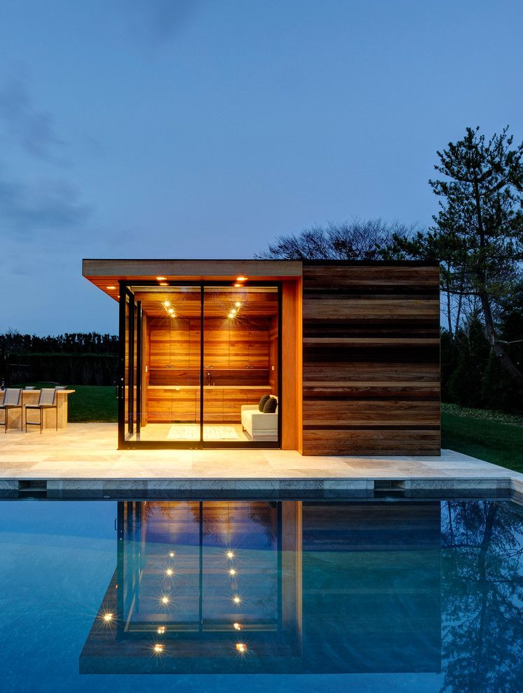 Sauna vs Steam Room for a Contemporary Pool with a Flat Roof and Sam's Creek by Bates Masi Architects Llc