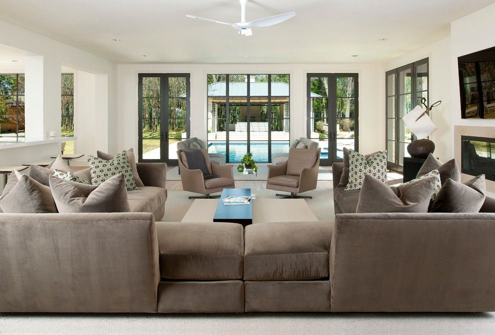 Scissor Doors for a Contemporary Family Room with a Neutral Tones and Northaven by Tatum Brown Custom Homes