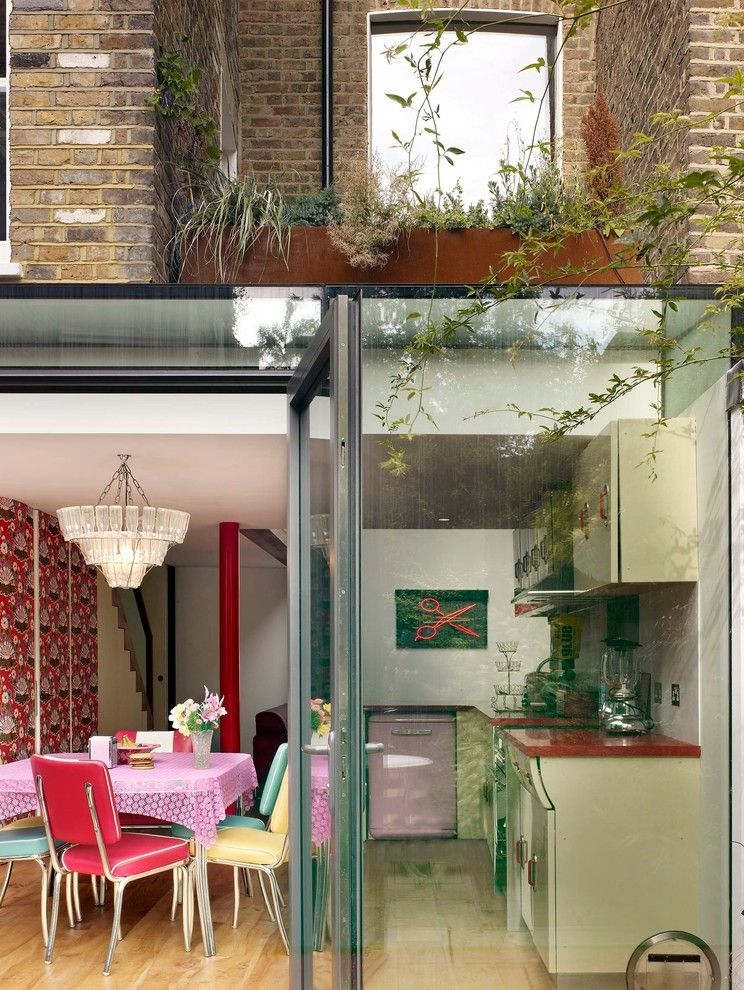 Scissor Doors for a Eclectic Exterior with a Glass Doors and Scissor House by Foster Lomas