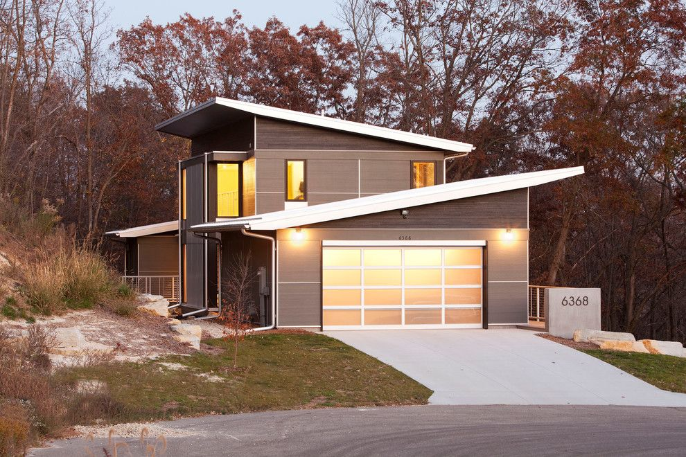 Scissor Doors for a Modern Exterior with a Mixed Siding and Zumbro Zen by Sala Architects