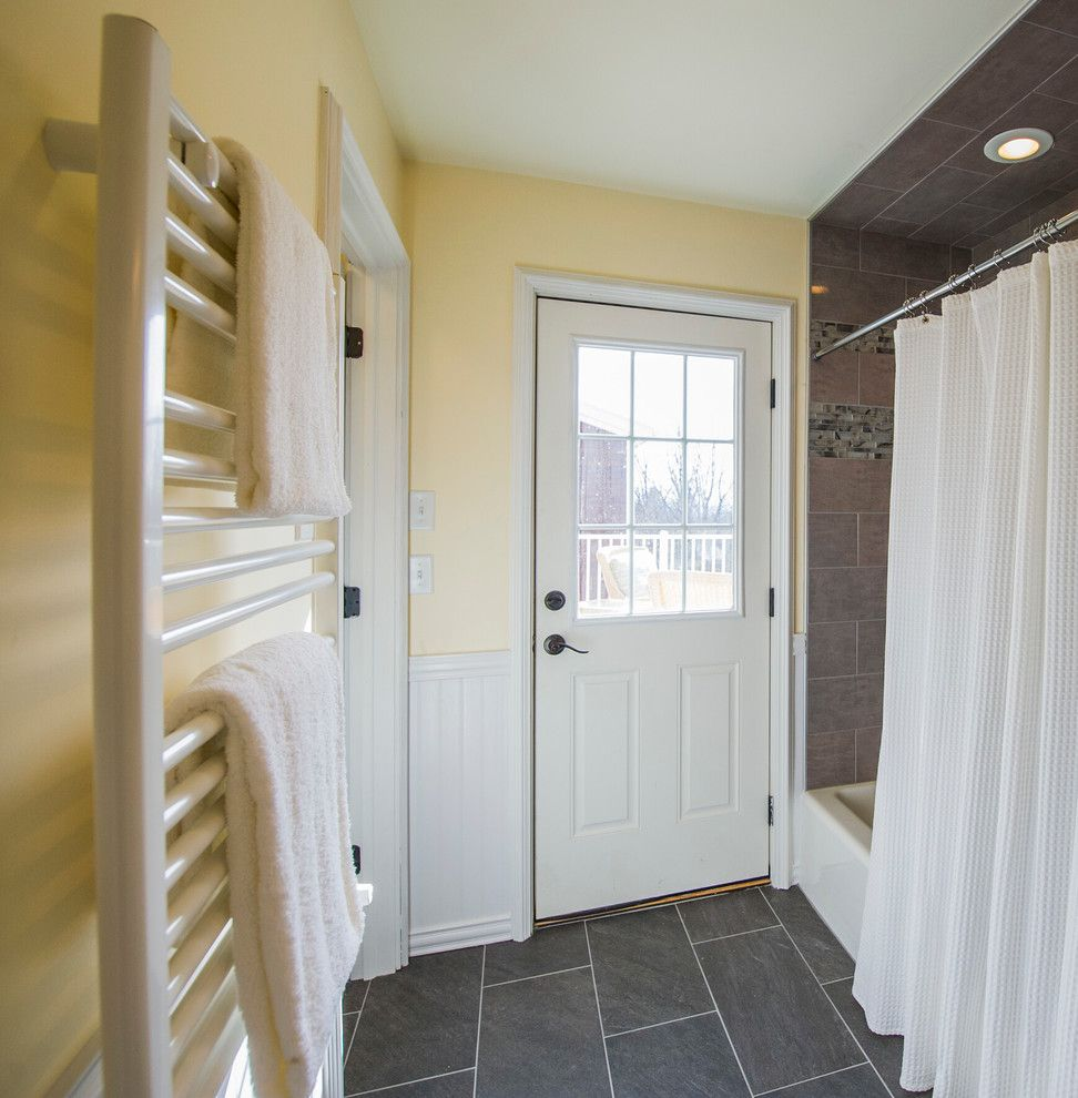 Scissor Doors for a  Spaces with a White Trim and Troy   Whole House Remodel by Razzano Homes and Remodelers, Inc.