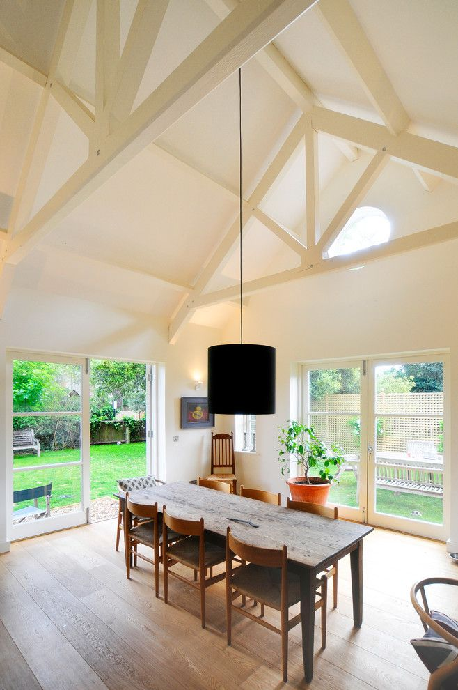 Scissor Doors for a Transitional Dining Room with a Terra Cotta Pot and North Oxford by Riach Architects