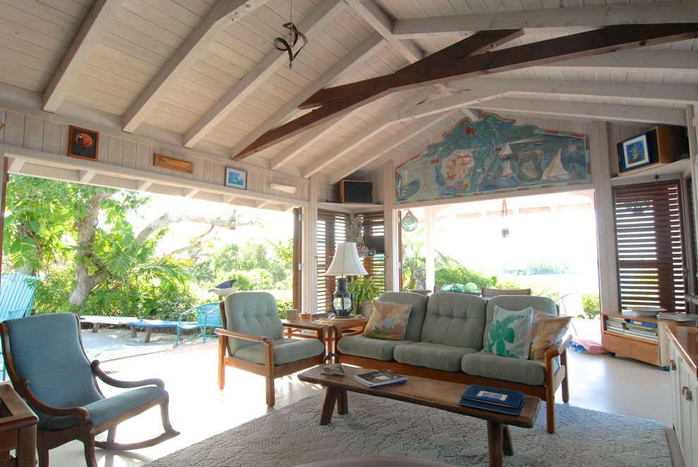 Scissor Doors for a Tropical Living Room with a Wood Coffee Table and Bahamian Open House by Brenda Olde