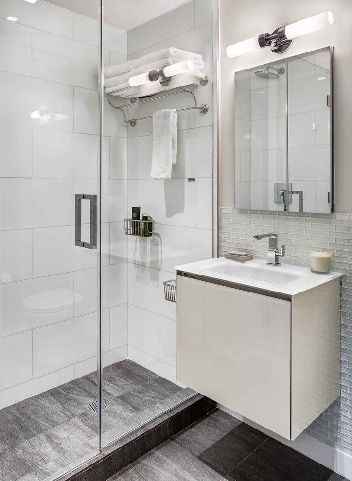 Sconce Definition for a Contemporary Bathroom with a Towel Shelf and Bowery-Downtown Manhattan Residence by United Elite Group