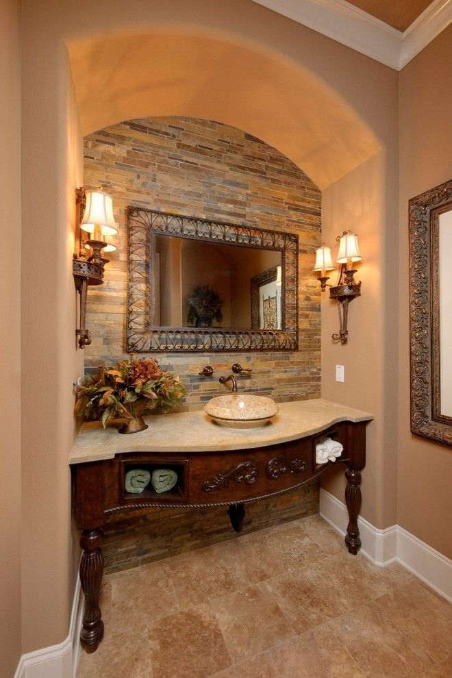 Sconce Definition for a Mediterranean Powder Room with a Wall Sconces and Wood Forest by Gary Keith Jackson Design Inc