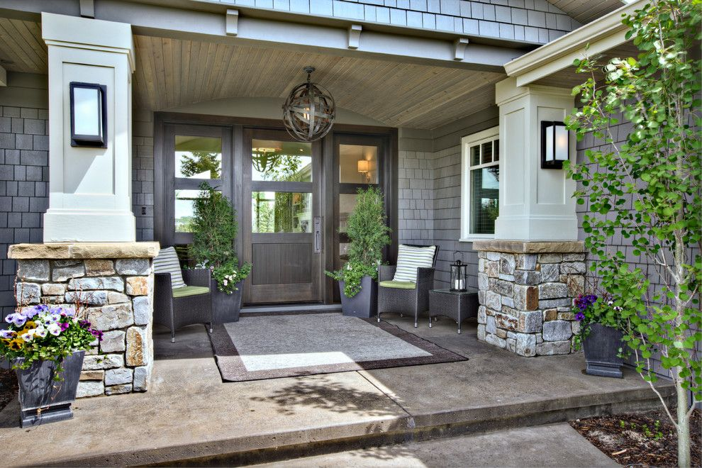 Sconces Definition for a Contemporary Porch with a Outdoor Furniture and Traditional Style at Its Best by Rockwood Custom Homes