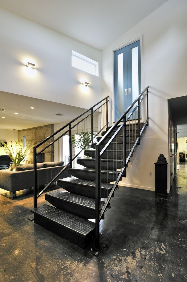Sconces Definition for a Industrial Staircase with a Dark Floor and Custom Stair by Rd Architecture, Llc