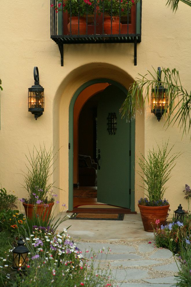 Sconces Definition for a Mediterranean Entry with a Outdoor Potted Plant and Spanish Colonial Revival in La Canada Flintridge Ca by Sue Eller of Rsir