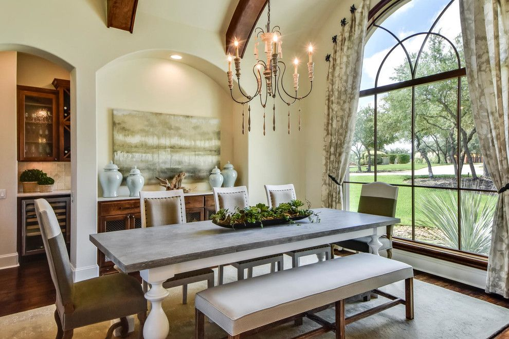 Scott Felder Homes for a Mediterranean Dining Room with a Arched Window and Zen Gardens by Heather Scott Home & Design